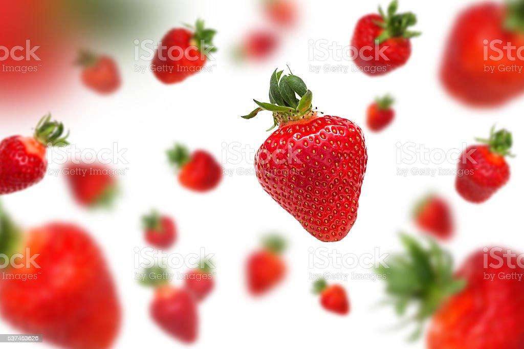 Jumping strawberries stock photo