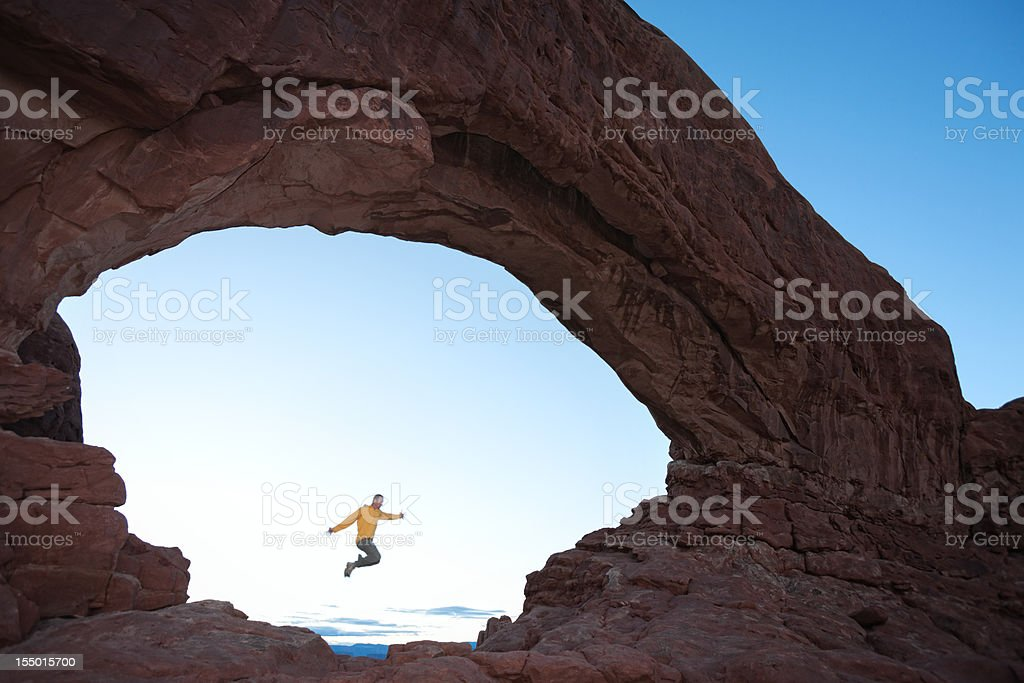 Jumping through the North Window at Arches National Park. stock photo