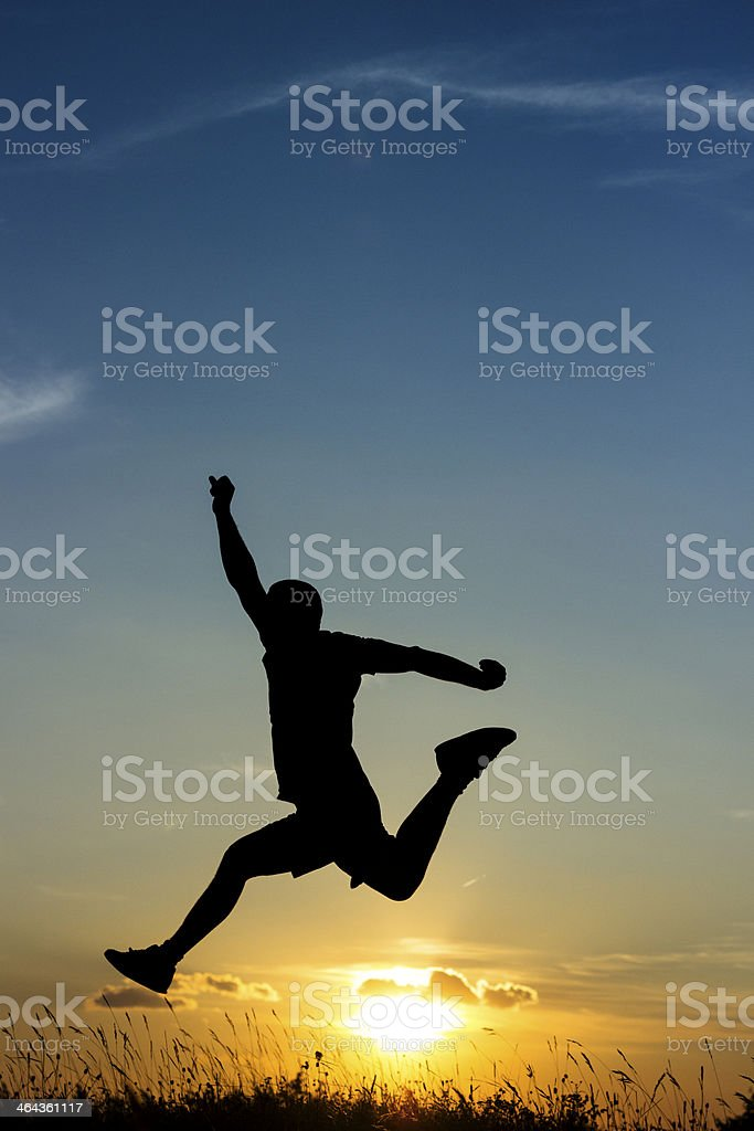 Jumping to freedom, sunset royalty-free stock photo
