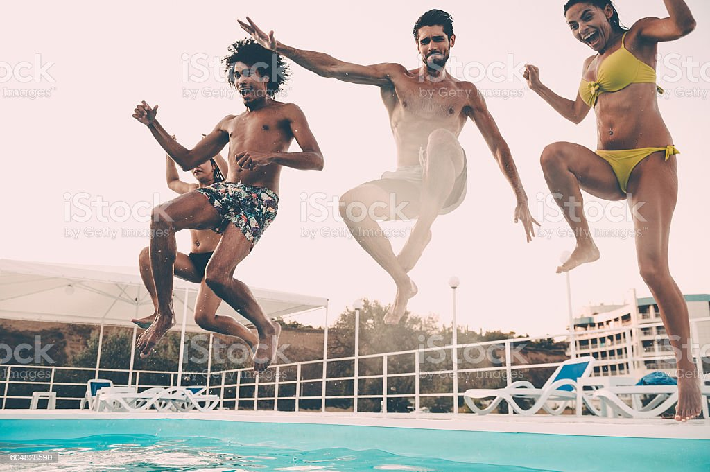 Jumping to the pool. stock photo