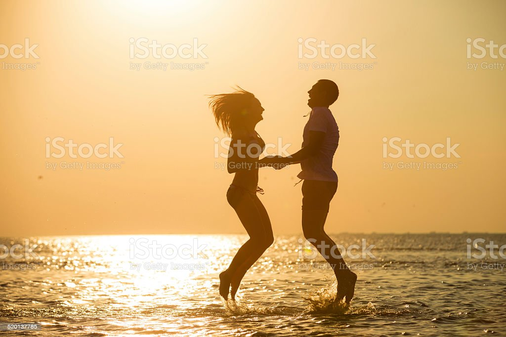 jumping to the sky at sunset royalty-free stock photo