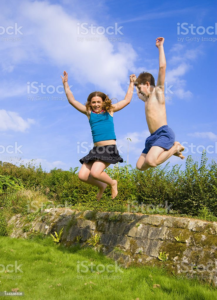 Jumping together royalty-free stock photo