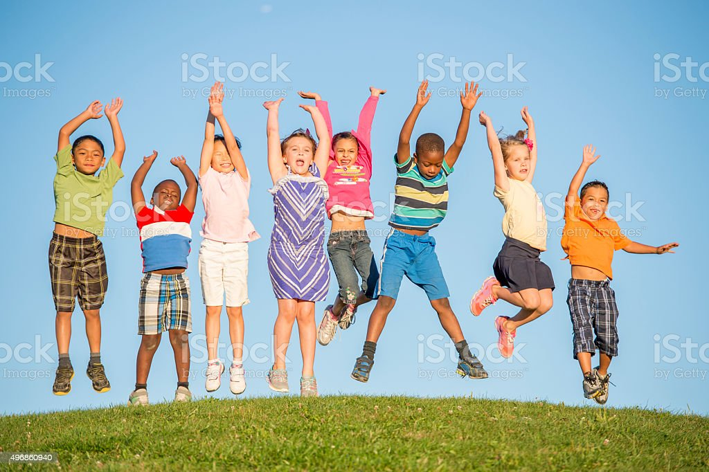 Jumping up in the Air on a Hill Top stock photo