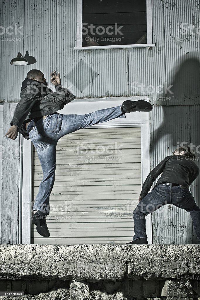 Jumping up to Kick in Kenpo Karate on the Street royalty-free stock photo