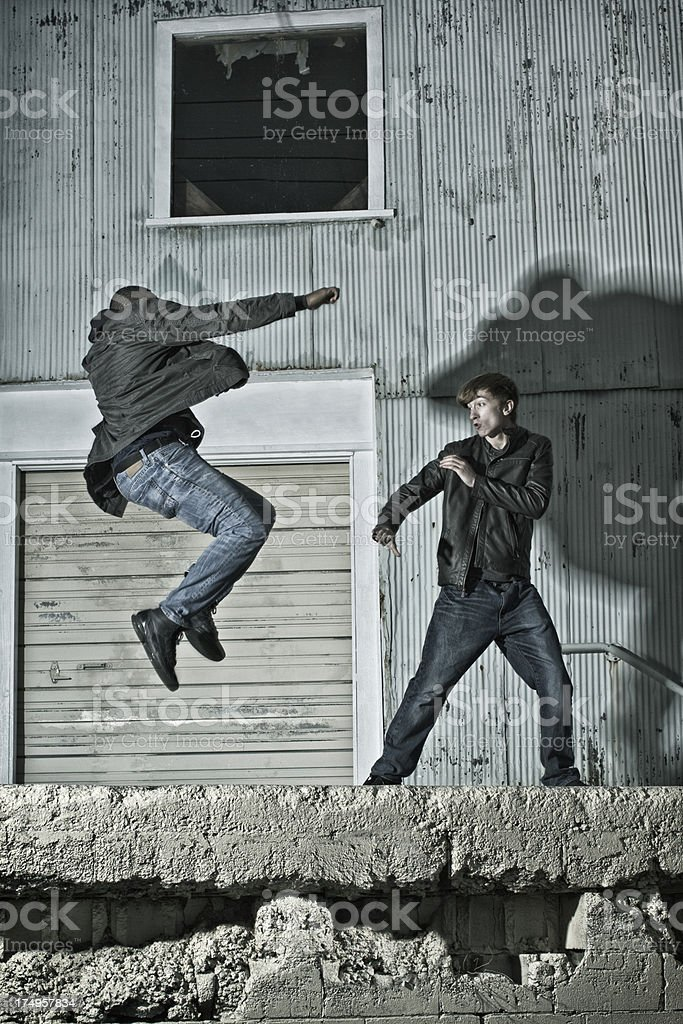 Jumping up to Kick in Kenpo Karate on the Street stock photo