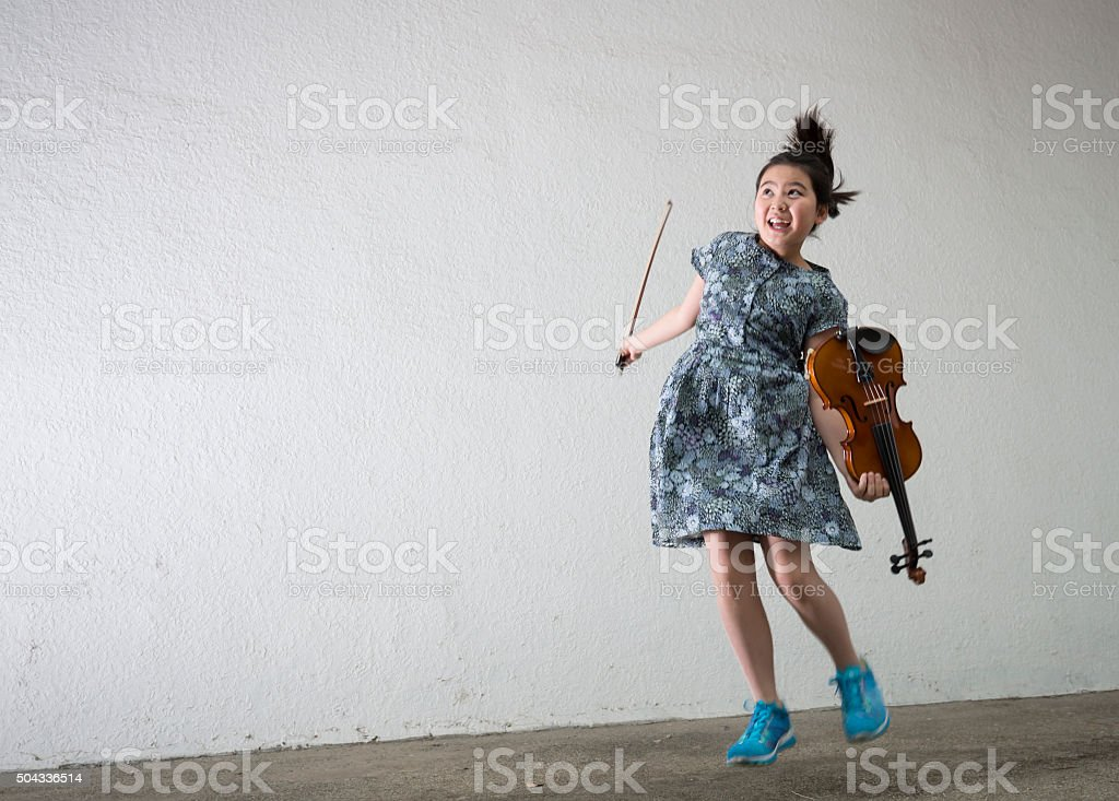 Jumping Violinist stock photo