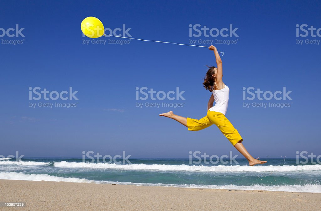 Jumping with balloons royalty-free stock photo