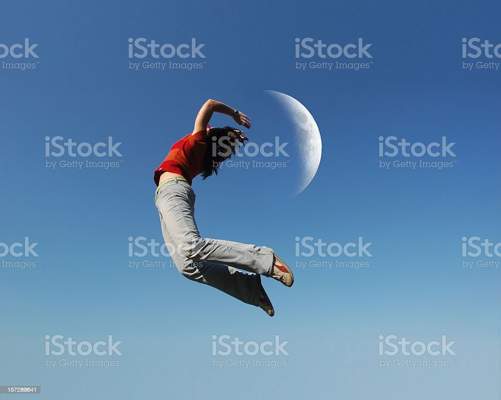 jumping with the moon stock photo