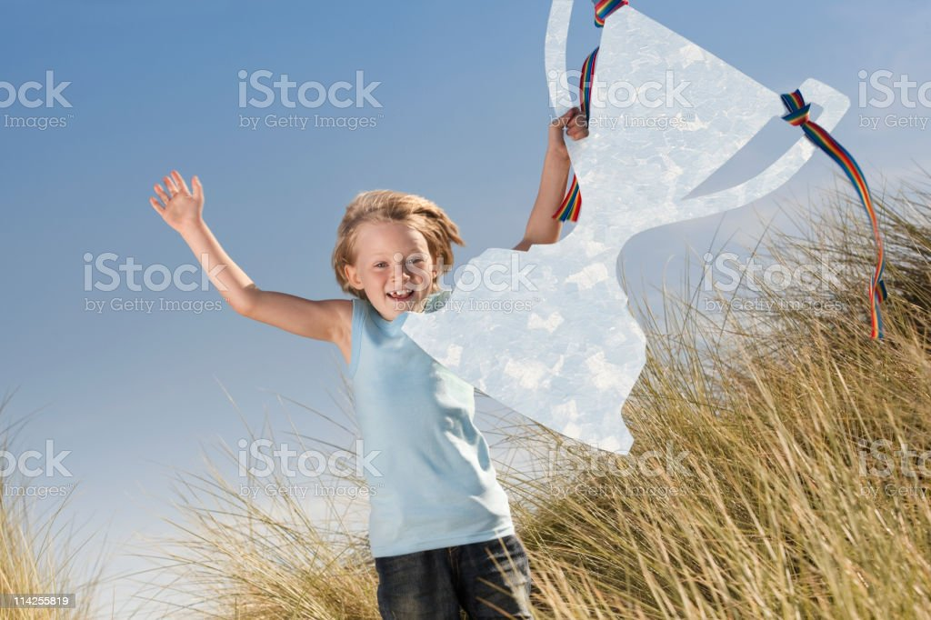 Jumping with trophy in hand (XXL) stock photo