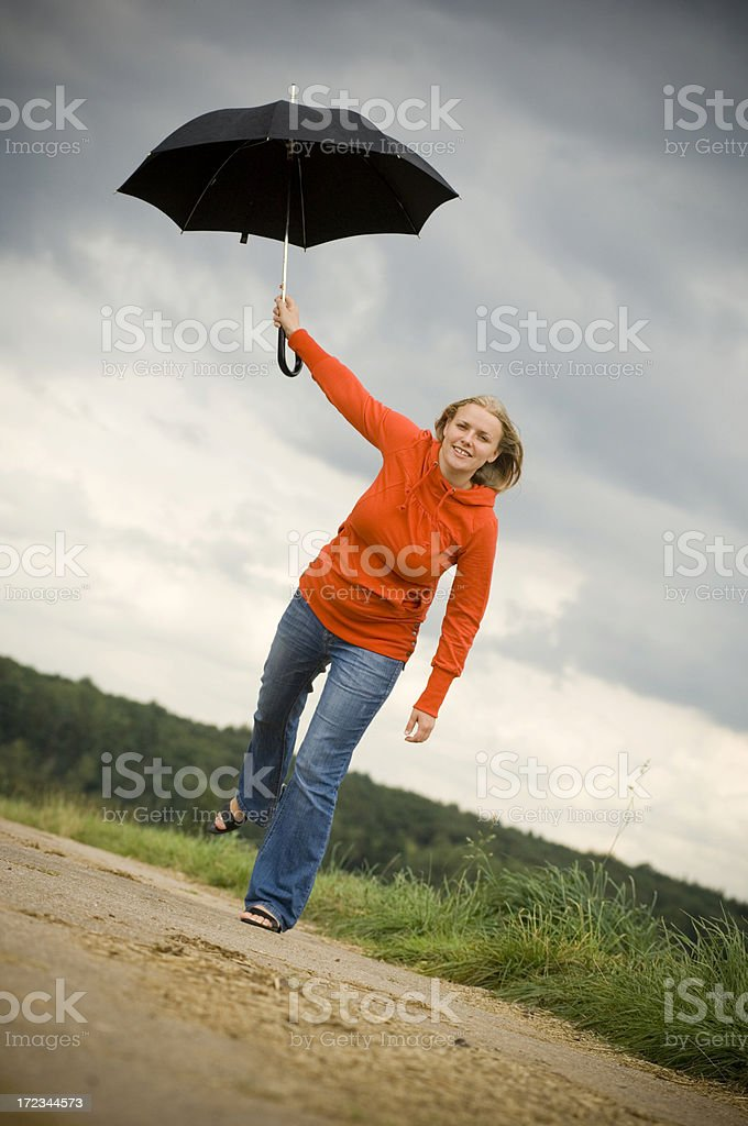 Jumping with umbrella royalty-free stock photo