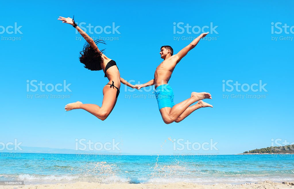 Jumps high up on the beach. royalty-free stock photo