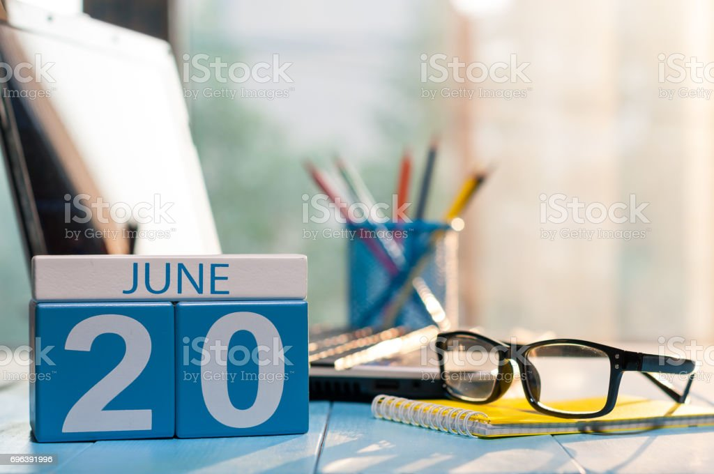 June 20th. Day 20 of month, wooden color calendar on business background. Summer time. Empty space for text stock photo