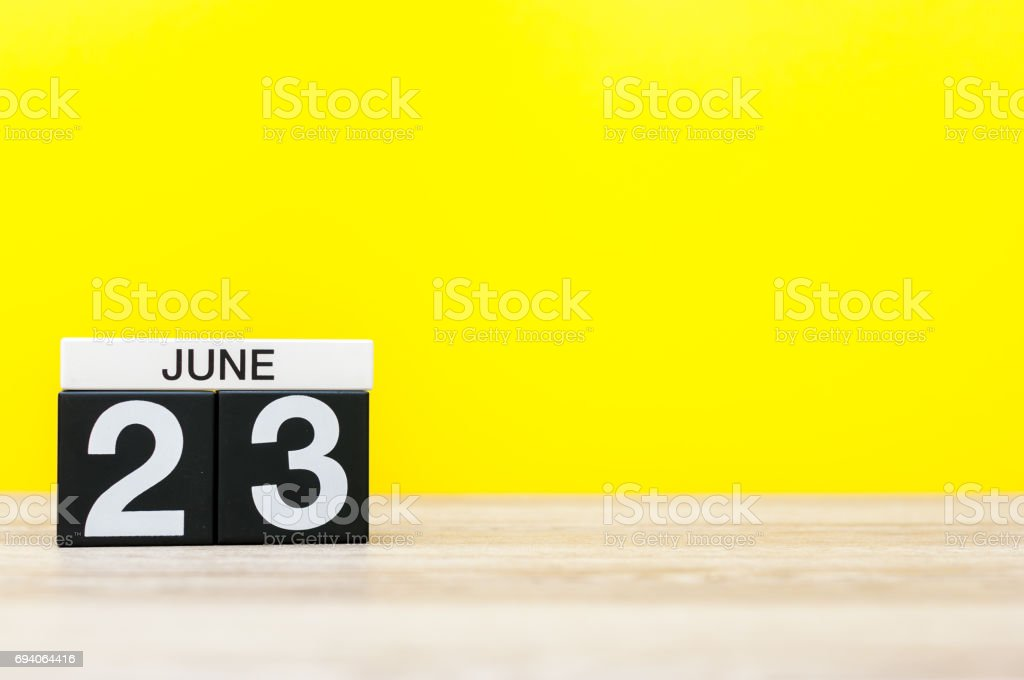 June 23rd. Day 23 of month, calendar on yellow background. Summer day. Empty space for text. International Olympic Day stock photo