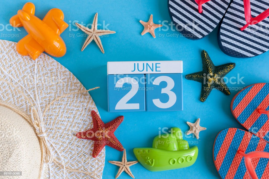 June 23rd. Image of june 23 calendar on blue background with summer beach, traveler outfit and accessories. Summer day stock photo