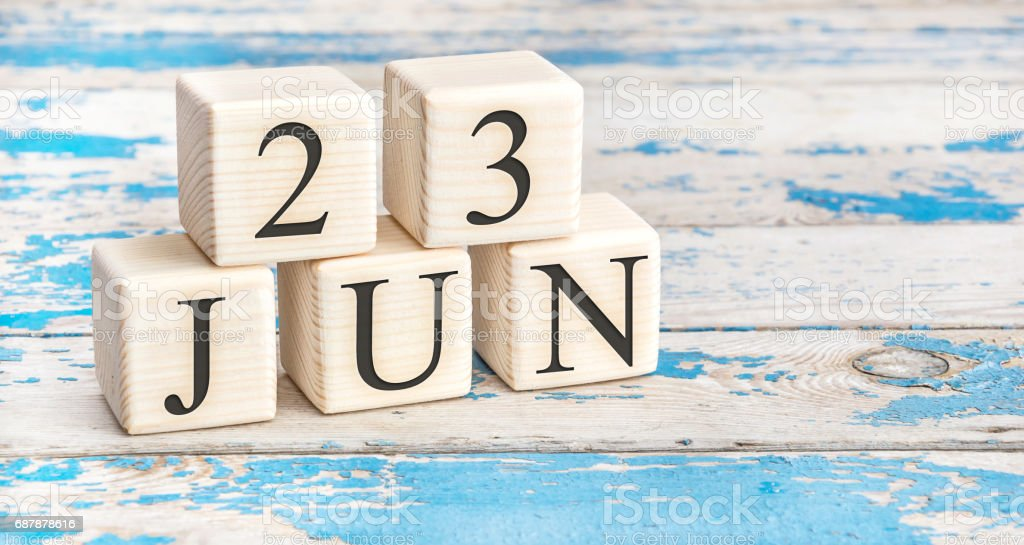 June 23rd. Wooden cubes with date of 23 June on old blue wooden background. stock photo