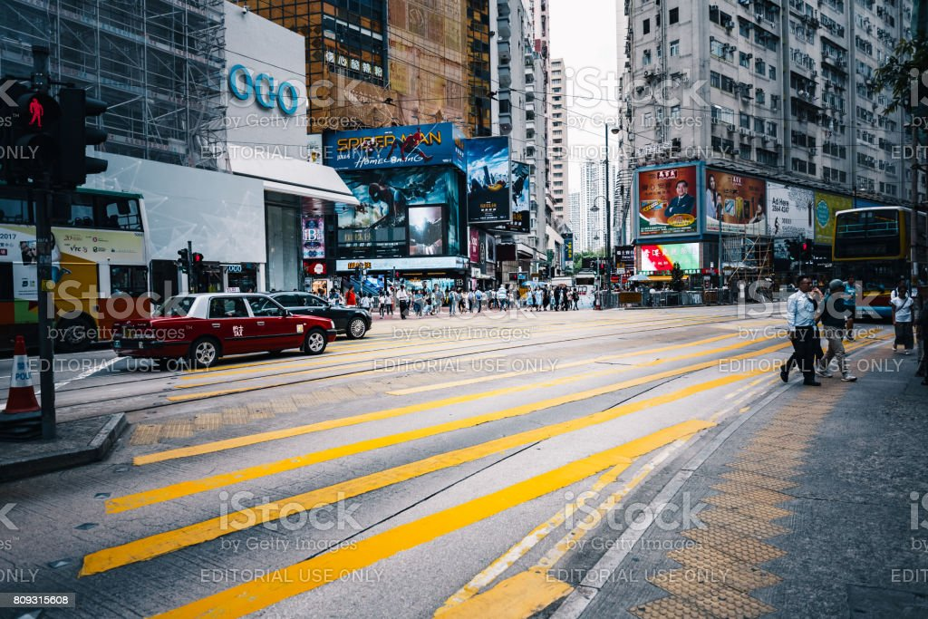 June 27, 2017, Hennessy Road, Causeway Bay, Hong Kong -  People walking across Hennessy Road, Causeway Bay at day stock photo