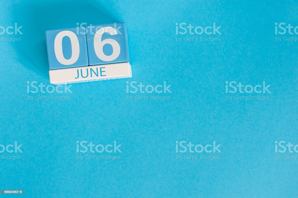 June 6th. Image of june 6 wooden color calendar on blue background. Summer day, empty space for text stock photo