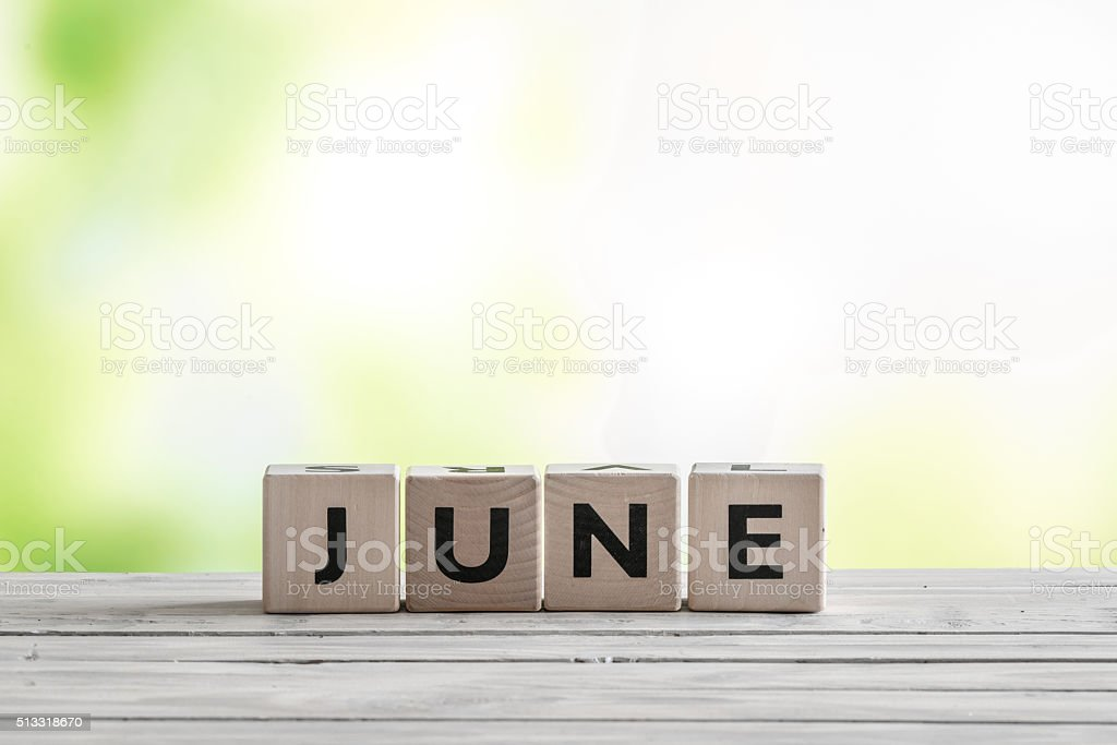 June sign on wooden blocks stock photo
