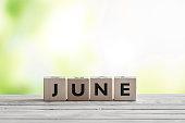 June sign on wooden blocks