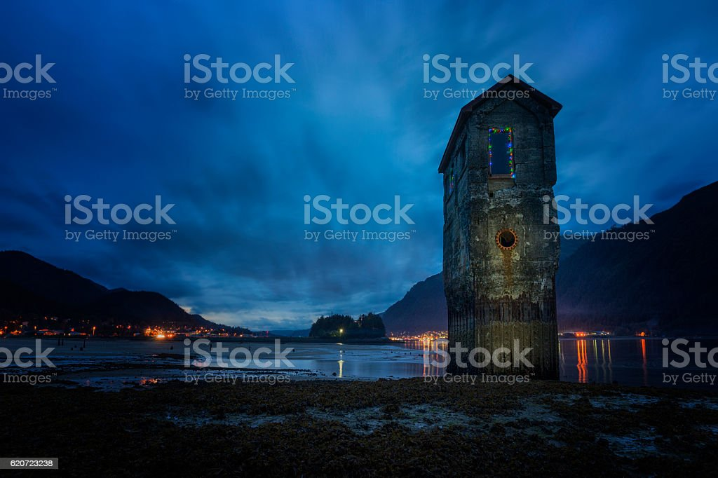 Juneau Salt pump at night with blurred clouds stock photo