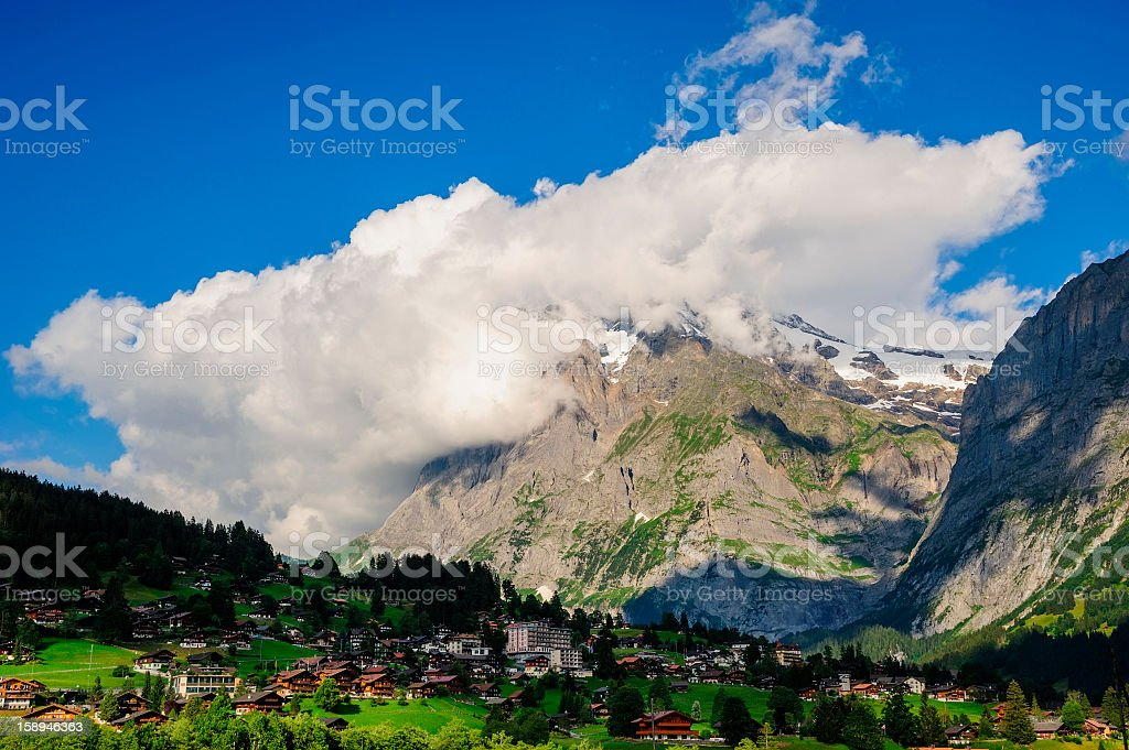 Jungfrau and Grindelwald Village in Berner Oberland, Switzerland stock photo