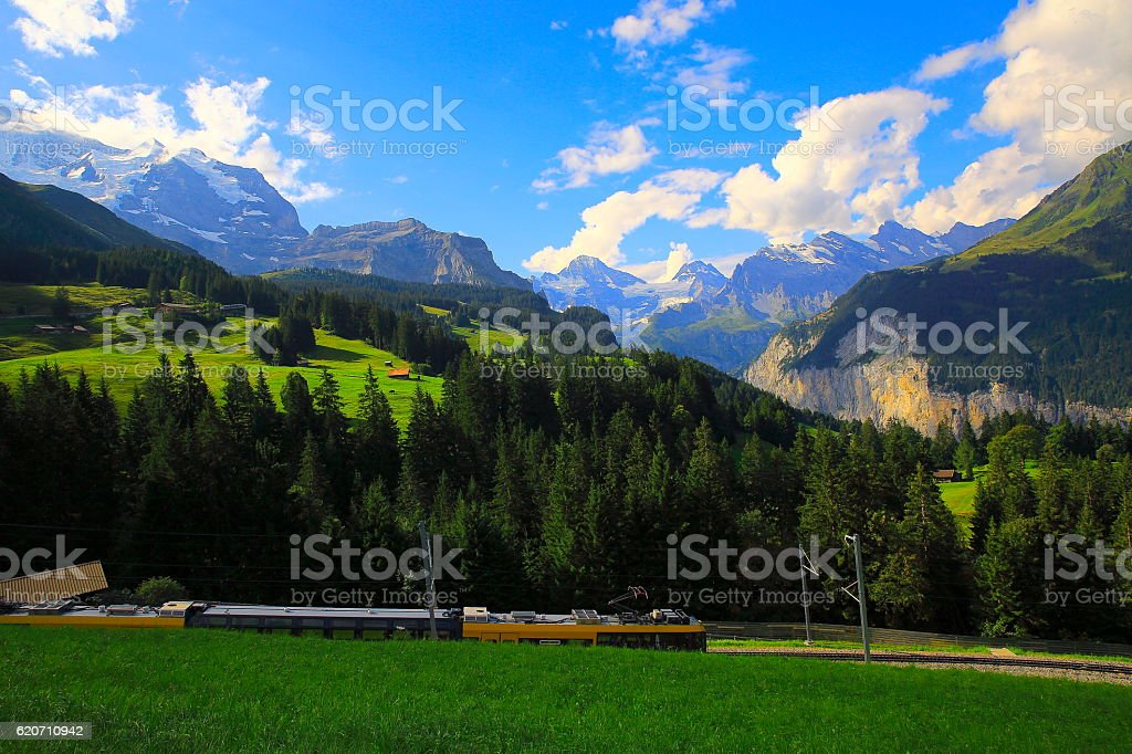 Jungfrau and Train, Wengen Alpine village, Lauterbrunnen valley, Swiss Alps stock photo