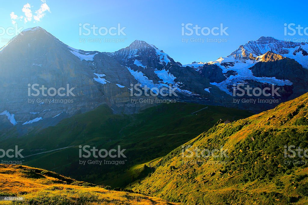 Jungfrau, Eiger and Monch at sunrise, Bernese Oberland, Swiss Alps stock photo