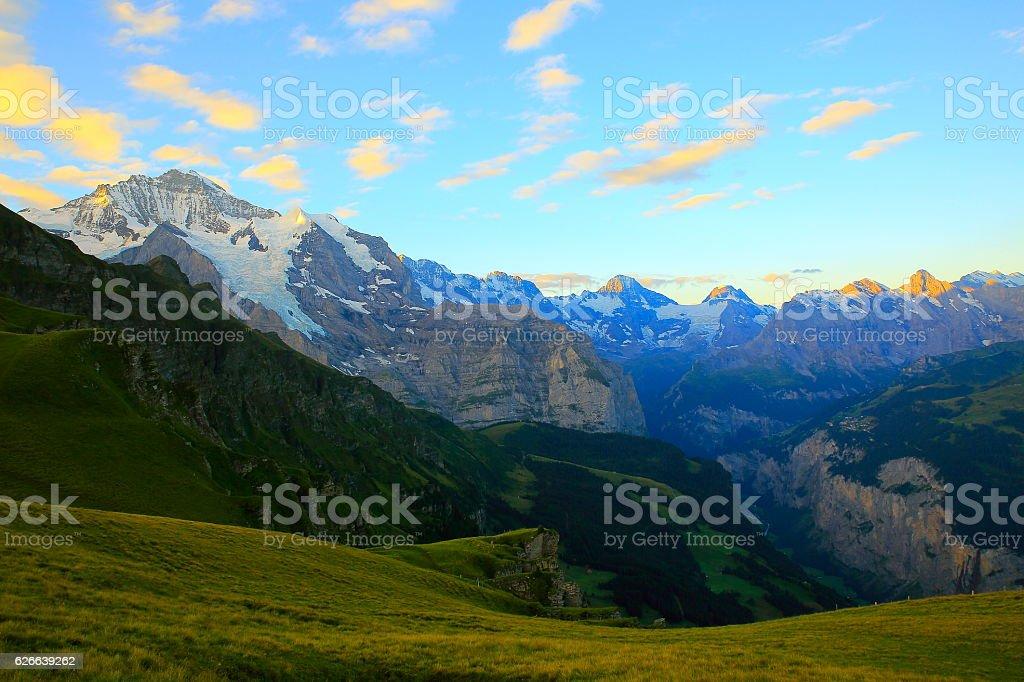 Jungfrau massif dawn, above lauterbrunnen valley, Bernese Oberland, Swiss Alps stock photo