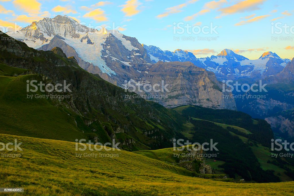 Jungfrau massif dawn, above lauterbrunnen valley, Bernese Oberland, Swiss Alps stock photo