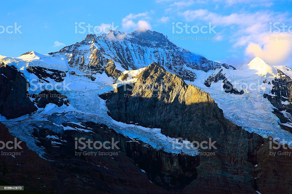 Jungfrau massif sunrise above Kleine Scheidegg, Bernese Oberland, Swiss Alps stock photo