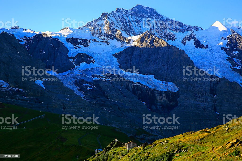 Jungfrau sunrise above Kleine Scheidegg valley, Bernese Oberland, Swiss Alps stock photo