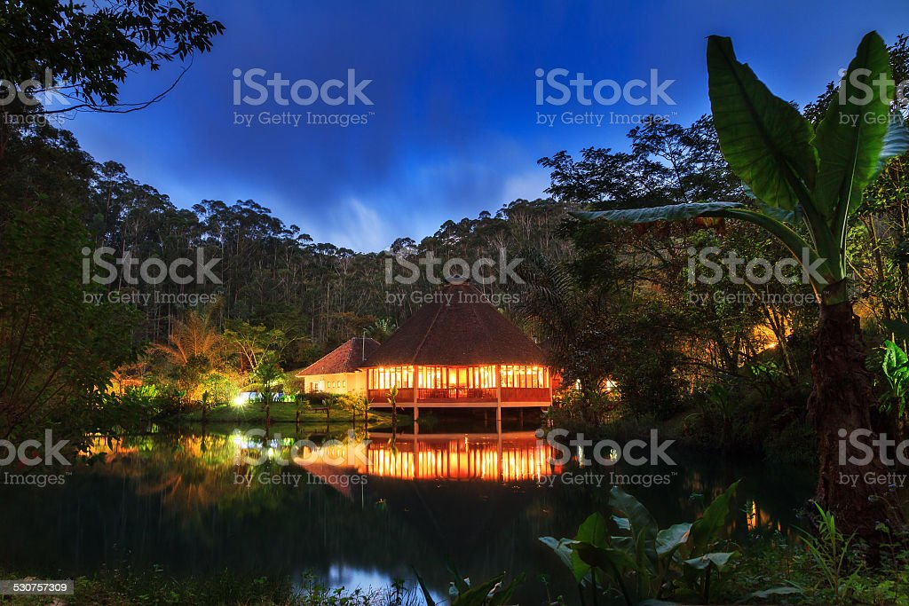 Jungle lodge night stock photo