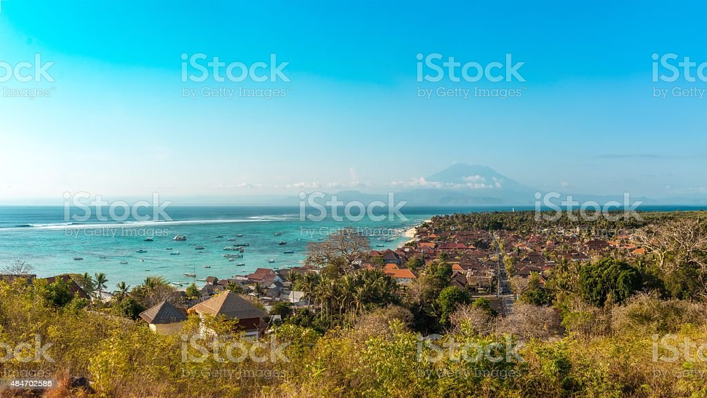 Jungutbatu Village with Mount Agung in the Background, Lembongan, Indonesia stock photo