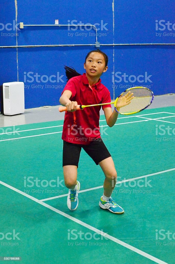 Junior badminton player stock photo