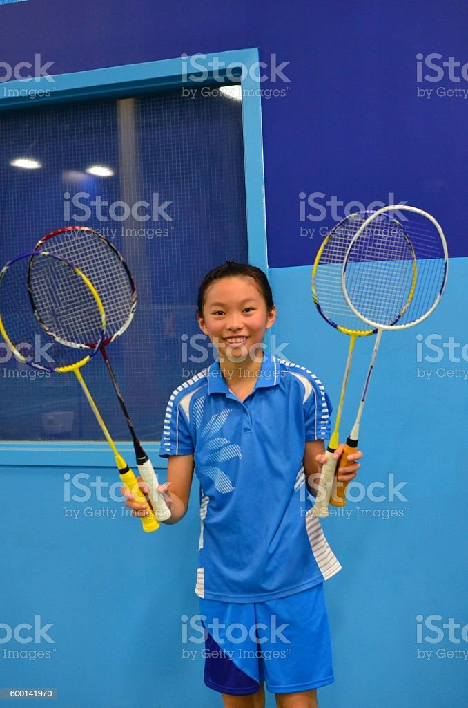Junior badminton player with rackets stock photo