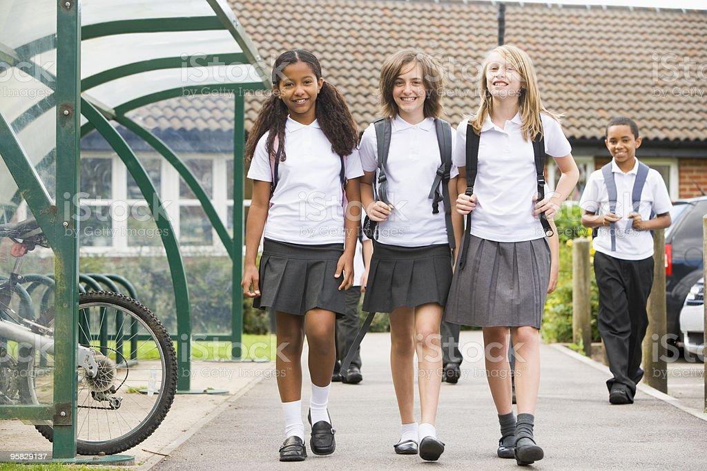 Junior children leaving school stock photo