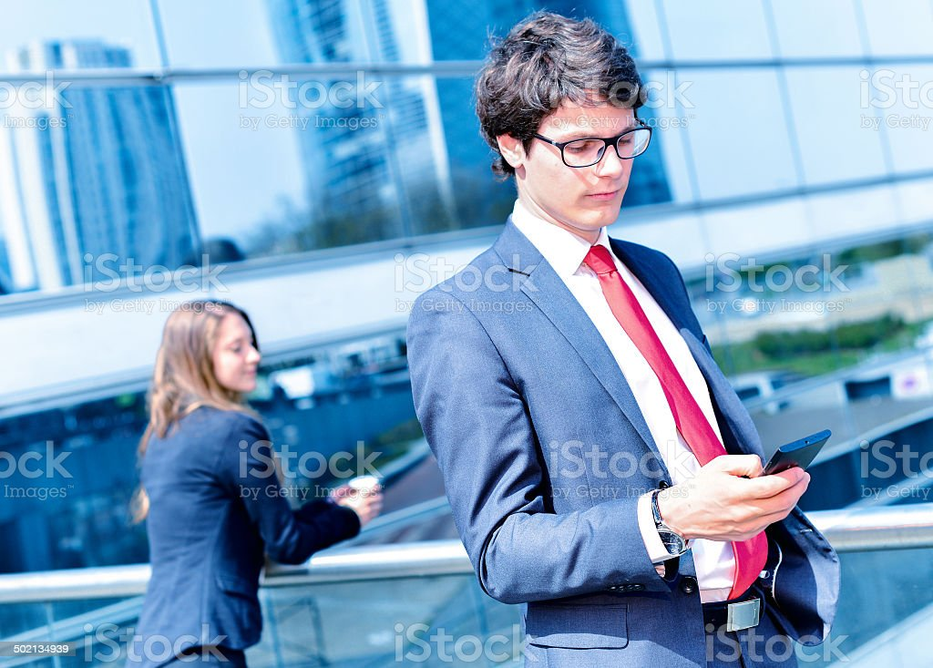 Junior executive dynamic phoning outside of his office royalty-free stock photo