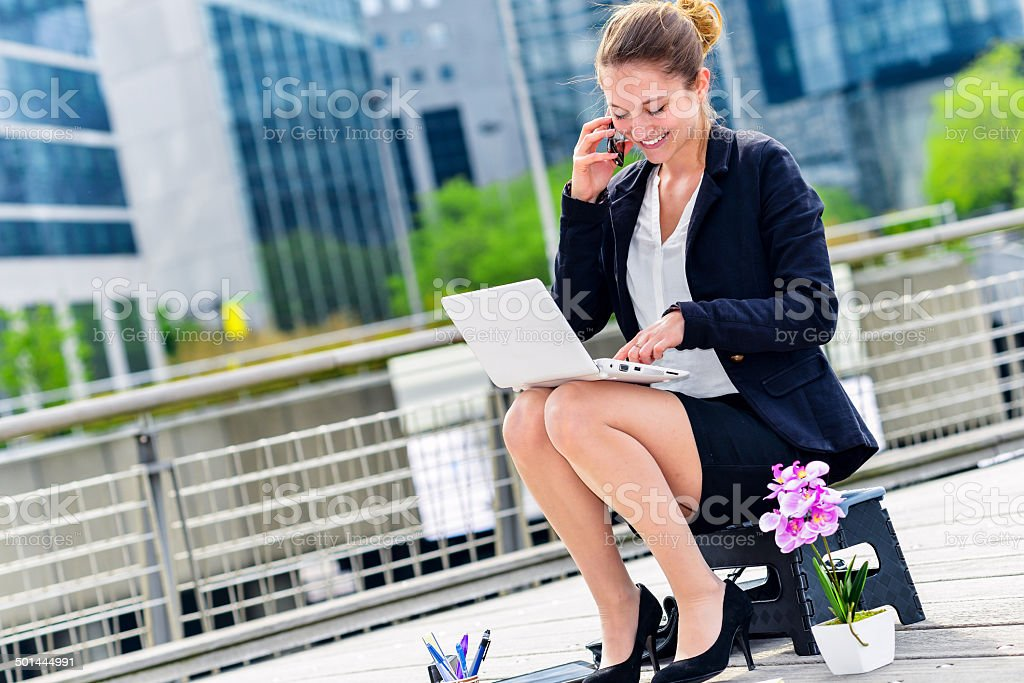 Junior executive dynamic working outside of her office royalty-free stock photo