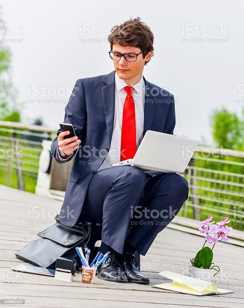 Junior executive dynamic working outside of his office royalty-free stock photo