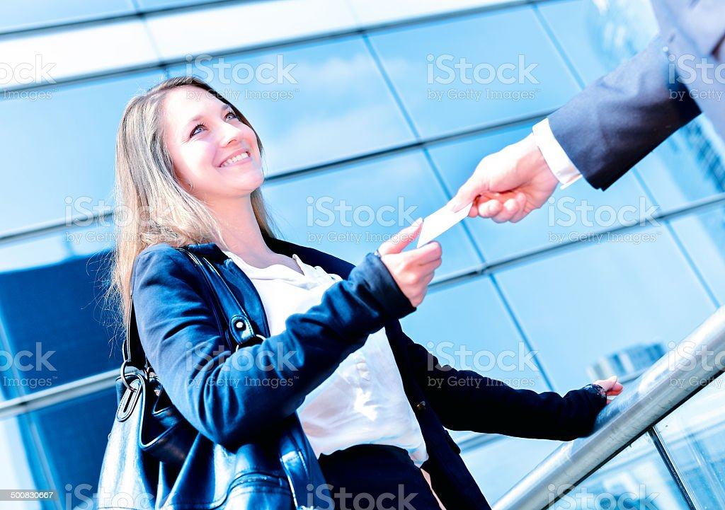 Junior executives dynamics exchange their business cards royalty-free stock photo