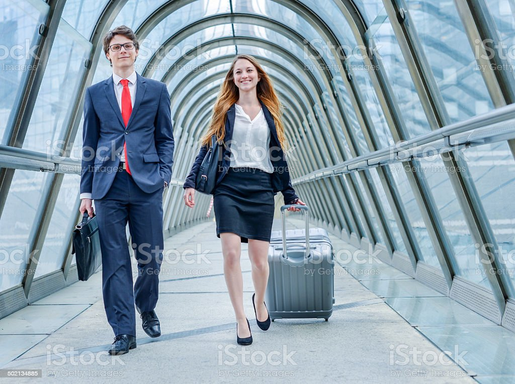 Junior executives dynamics in business trip royalty-free stock photo