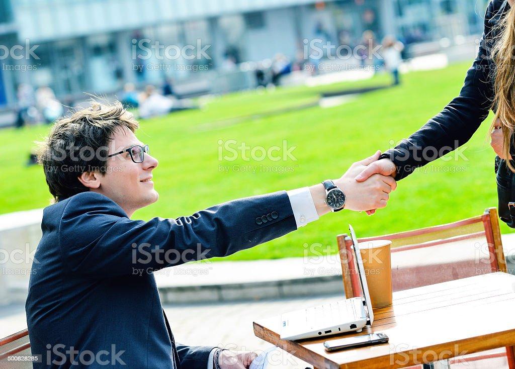 Junior executives dynamics shaking hands royalty-free stock photo