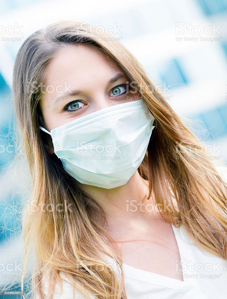 Junior executives dynamics  wearing protective face mask against royalty-free stock photo