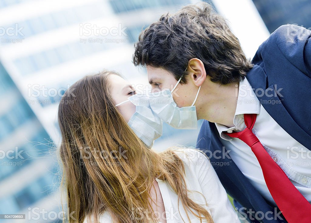 Junior executives dynamics  wearing protective face mask royalty-free stock photo