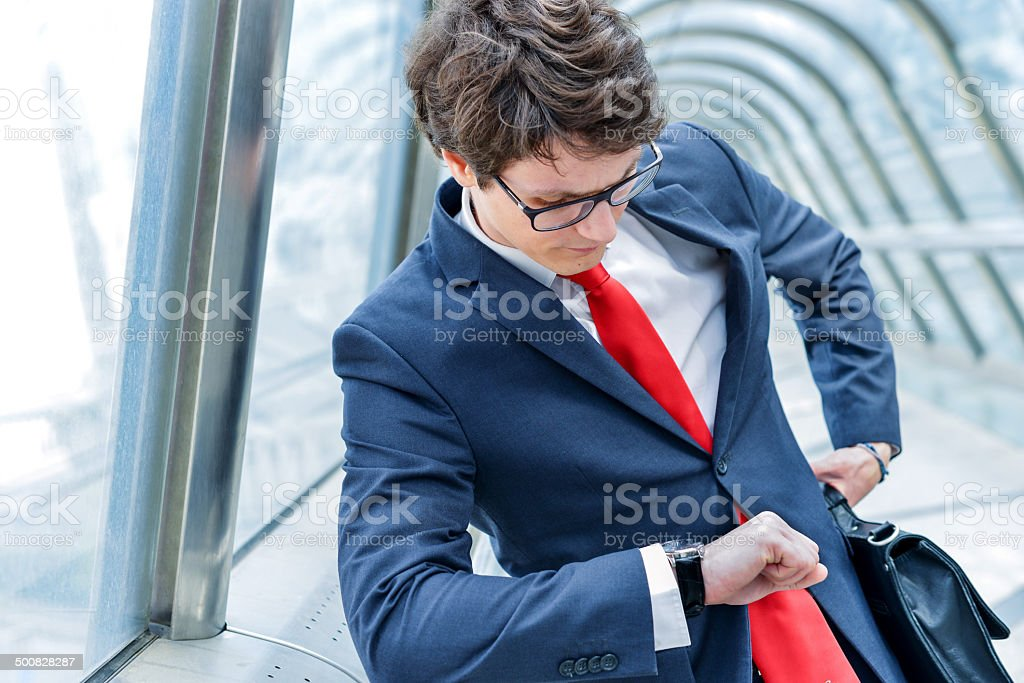 Junior executives of company watching time royalty-free stock photo