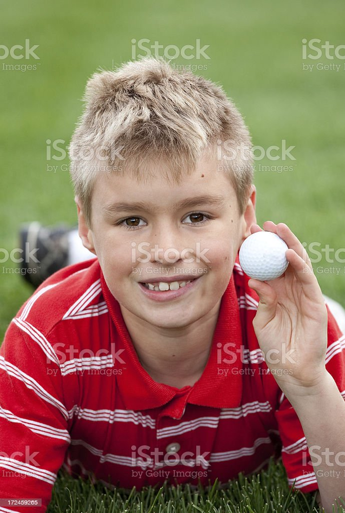 Junior Golfer Holding Golf Ball royalty-free stock photo