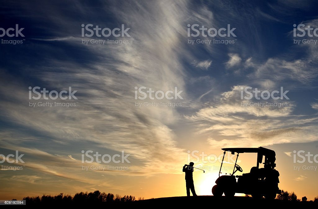 Junior Golfer Silhouette With Golf Cart stock photo