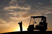 Junior Golfer Silhouette With Golf Cart