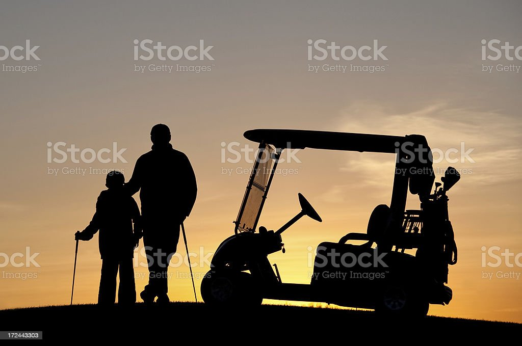 Junior Golfer With Father royalty-free stock photo
