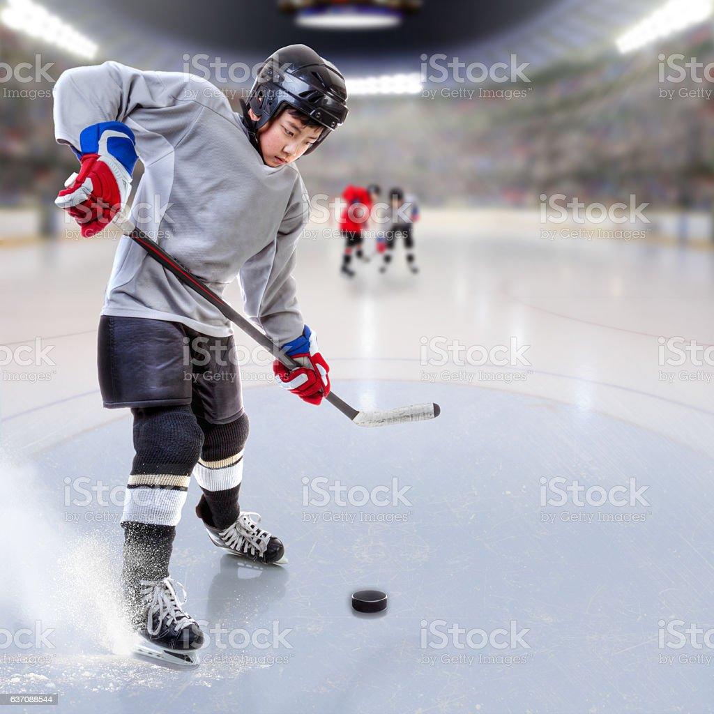 Junior Hockey Player Puck Handling in Arena stock photo